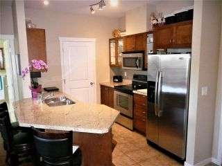 """Photo 2: 401 2336 WHYTE Avenue in Port Coquitlam: Central Pt Coquitlam Condo for sale in """"CENTREPOINTE"""" : MLS®# R2378939"""