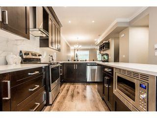 "Photo 10: 105 13670 62 Avenue in Surrey: Panorama Ridge Townhouse for sale in ""Panorama 62"" : MLS®# R2583169"