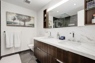 Photo 16: 503 138 Waterfront Court SW in Calgary: Chinatown Apartment for sale : MLS®# A1084870