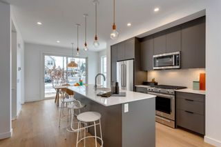 Photo 5: 1940 Bowness Road NW in Calgary: West Hillhurst Semi Detached for sale : MLS®# A1146767