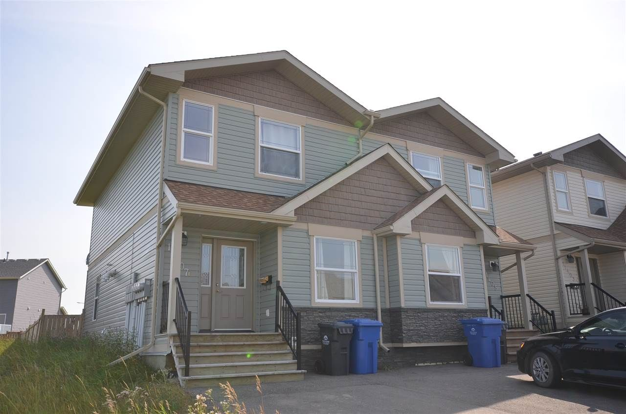Photo 1: Photos: 11407 89A Street in Fort St. John: Fort St. John - City NE 1/2 Duplex for sale (Fort St. John (Zone 60))  : MLS®# R2143713