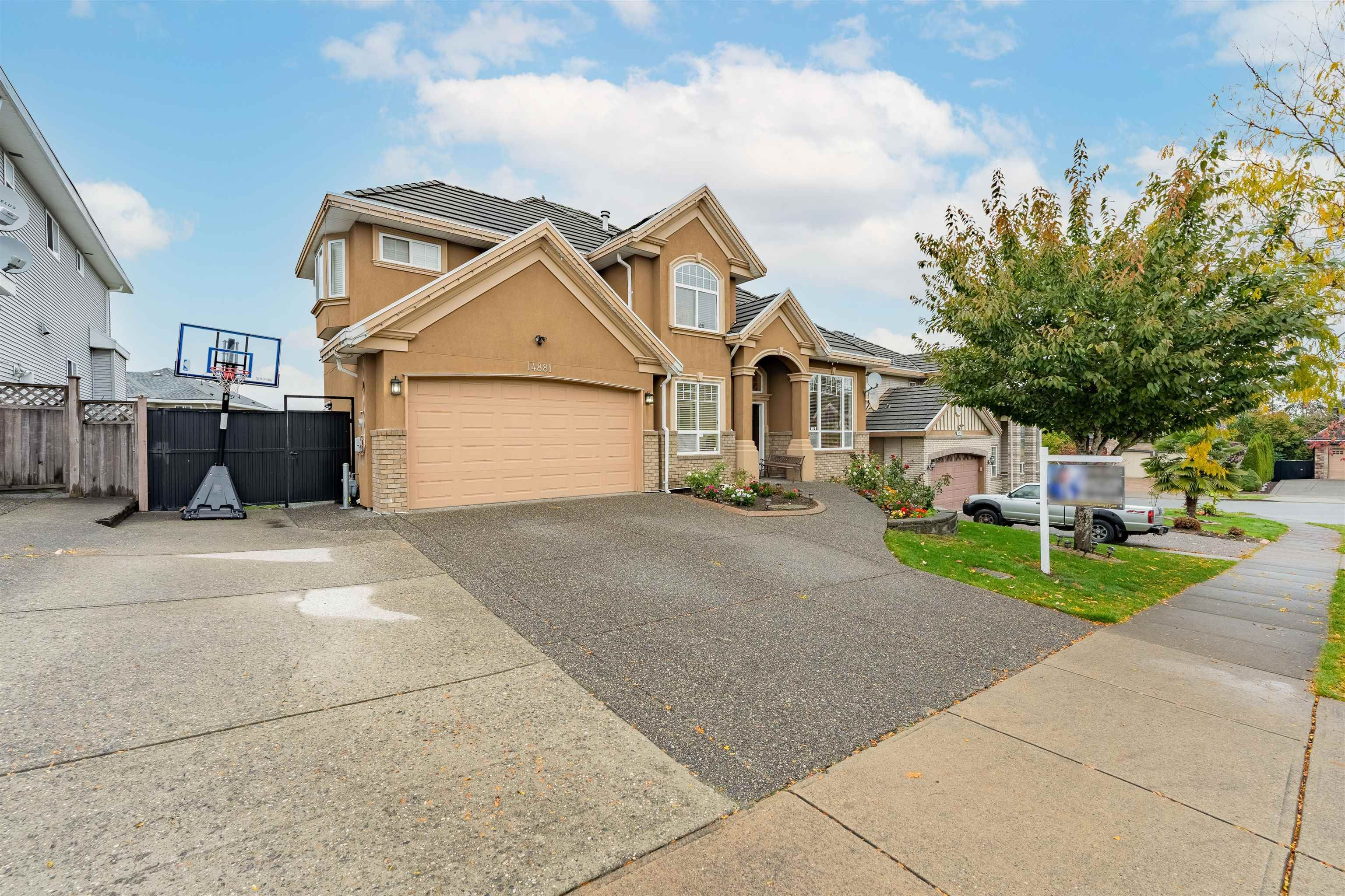 Main Photo: 14881 74A Avenue in Surrey: East Newton House for sale : MLS®# R2625718