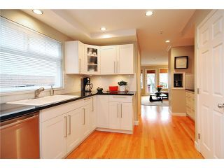 """Photo 3: 1865 E 7TH Avenue in Vancouver: Grandview VE 1/2 Duplex for sale in """"""""THE DRIVE"""""""" (Vancouver East)  : MLS®# V863836"""
