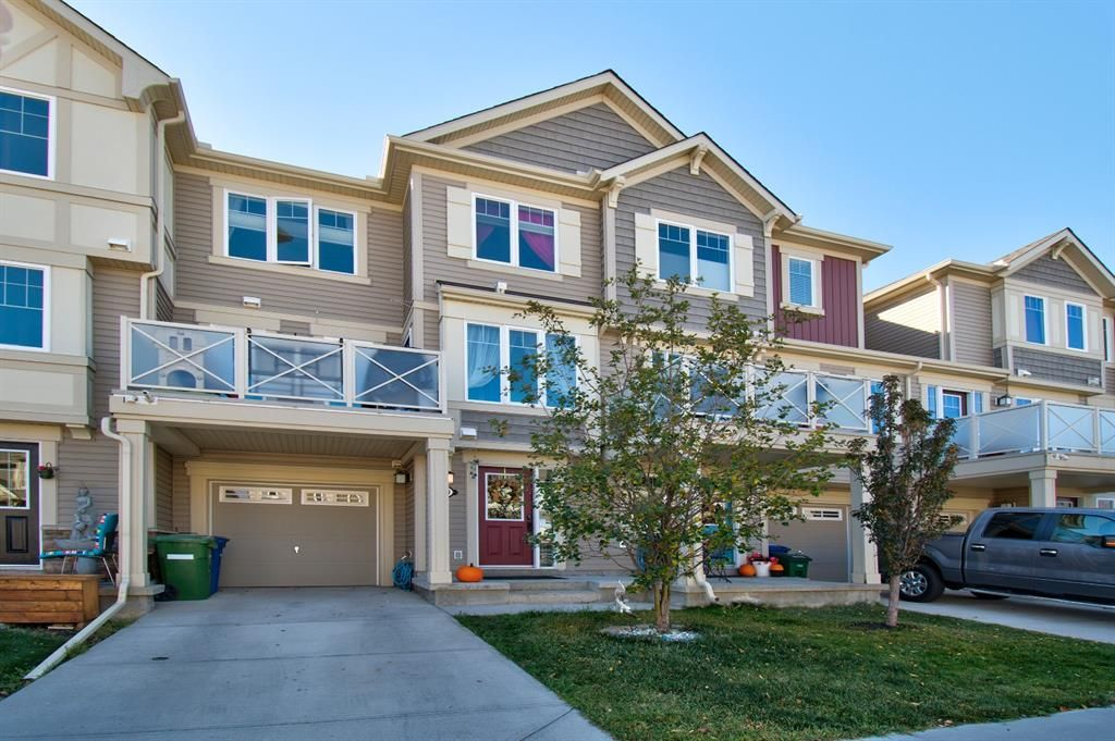 Main Photo: 149 WINDSTONE Avenue SW: Airdrie Row/Townhouse for sale : MLS®# A1033066