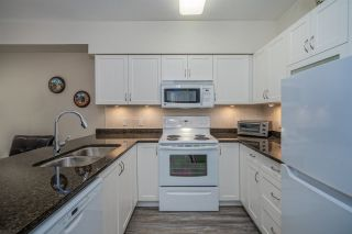"Photo 10: 403 16068 83 Avenue in Surrey: Fleetwood Tynehead Condo for sale in ""Fleetwood Gardens"" : MLS®# R2521959"