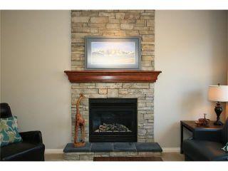 Photo 6: 188 SUNSET Close: Cochrane House for sale : MLS®# C4115906