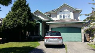 Photo 1: 8067 136A Street in Surrey: Bear Creek Green Timbers House for sale : MLS®# R2178825