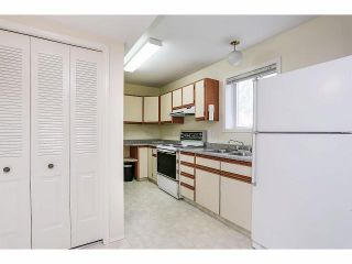 Photo 15: 9211 PRINCE CHARLES Boulevard in Surrey: Queen Mary Park Surrey House for sale : MLS®# F1409362