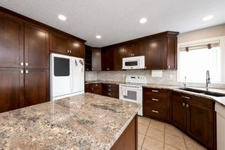 Photo 9: 112 Simcoe Close SW in Calgary: Signal Hill Detached for sale : MLS®# A1105867