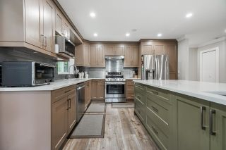 """Photo 14: 5059 199A Street in Surrey: Langley City House for sale in """"Nicomekl river"""" (Langley)  : MLS®# R2611778"""