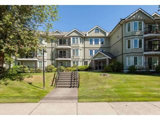 Photo 1: 104 20881 56 AVENUE in Langley: Langley City Condo for sale : MLS®# R2564873