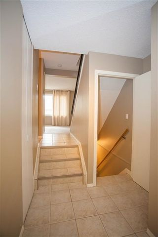 Photo 2: 189 CALLINGWOOD Place in Edmonton: Zone 20 Townhouse for sale : MLS®# E4246325