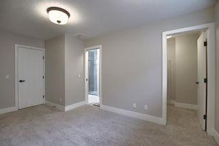 Photo 24: 374 Quarry Park Boulevard SE in Calgary: Douglasdale/Glen Row/Townhouse for sale : MLS®# A1063797