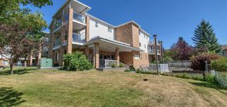 Photo 2: 110 165 MANORA Place NE in Calgary: Marlborough Park Apartment for sale : MLS®# A1028754