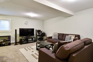 "Photo 24: 21038 77A Avenue in Langley: Willoughby Heights Condo for sale in ""IVY ROW"" : MLS®# R2474522"