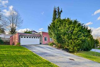Photo 1: 7887 SUNCREST Drive in Surrey: East Newton House for sale : MLS®# R2125728