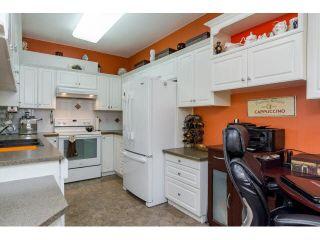"Photo 6: 414 13860 70TH Avenue in Surrey: East Newton Condo for sale in ""Chelsea Gardens"" : MLS®# F1448214"
