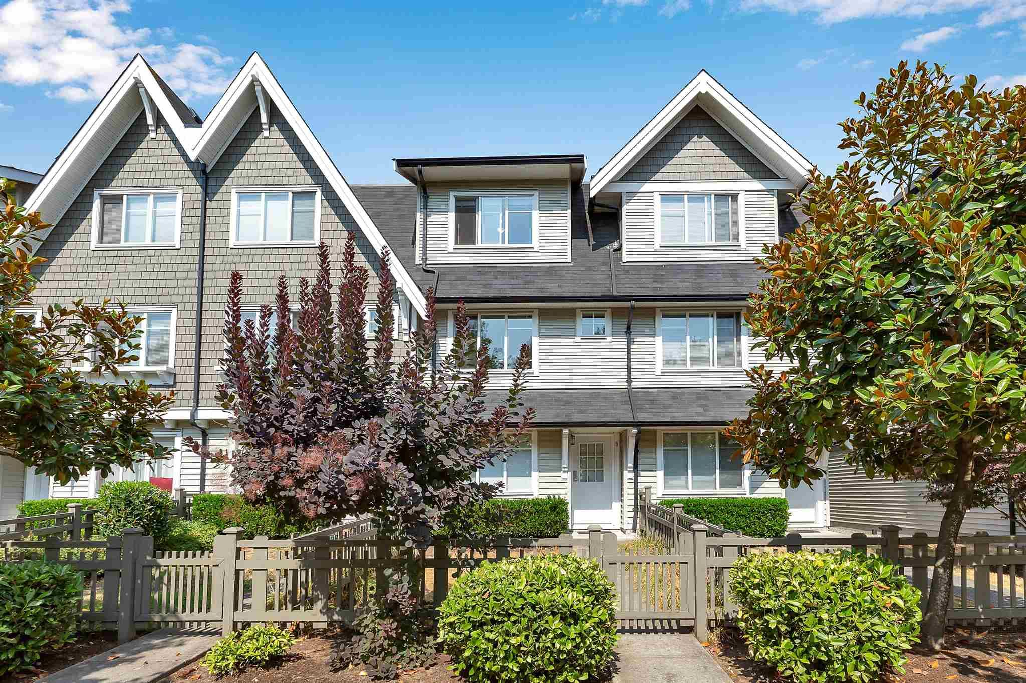 """Photo 1: Photos: 9 15871 85 Avenue in Surrey: Fleetwood Tynehead Townhouse for sale in """"Huckleberry"""" : MLS®# R2606668"""