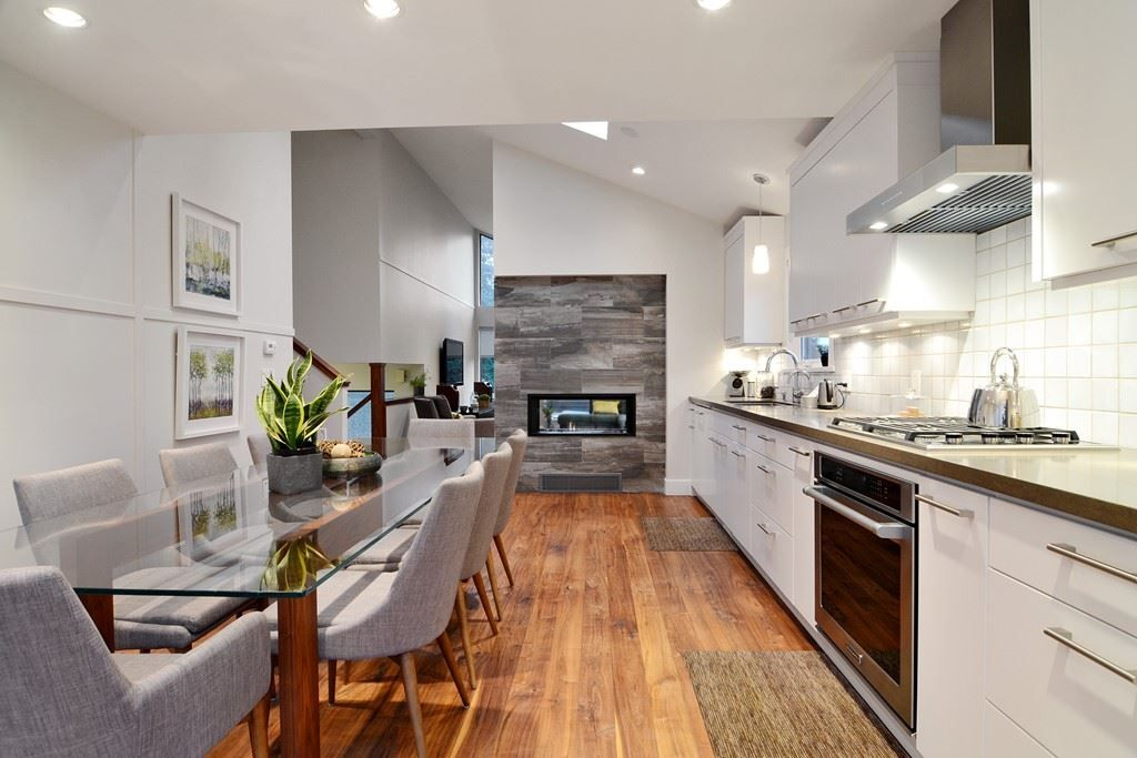 kitchen showcases composite  counter tops, stainless steel appliances' Wolf Gas range & Convection oven