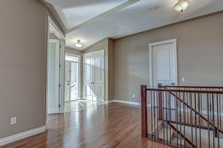 Photo 3: 72 Elysian Crescent SW in Calgary: Springbank Hill Semi Detached for sale : MLS®# A1148526