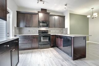 Photo 16: 102 Clydesdale Way: Cochrane Row/Townhouse for sale : MLS®# A1117864