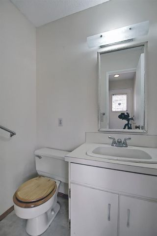 Photo 25: 329 Woodvale Crescent SW in Calgary: Woodlands Semi Detached for sale : MLS®# A1093334