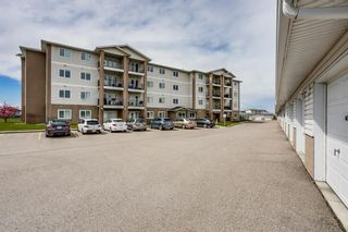 Photo 3: 401 300 Edwards Way NW: Airdrie Apartment for sale : MLS®# A1111826