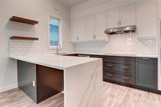 Photo 13: 2 137 24 Avenue NE in Calgary: Tuxedo Park Row/Townhouse for sale : MLS®# C4278414