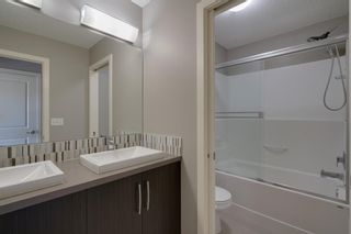 Photo 17: 111 Ascot Point SW in Calgary: Aspen Woods Row/Townhouse for sale : MLS®# A1144877