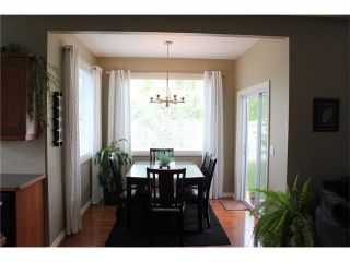 Photo 8: 242 CRYSTAL GREEN Point(e): Okotoks House for sale : MLS®# C4084538