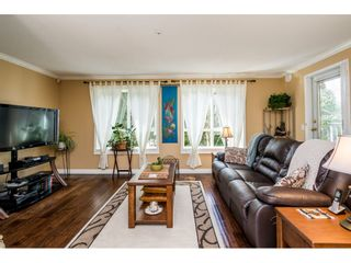 "Photo 4: 228 13880 70 Avenue in Surrey: East Newton Condo for sale in ""Chelsea Gardens"" : MLS®# R2563447"