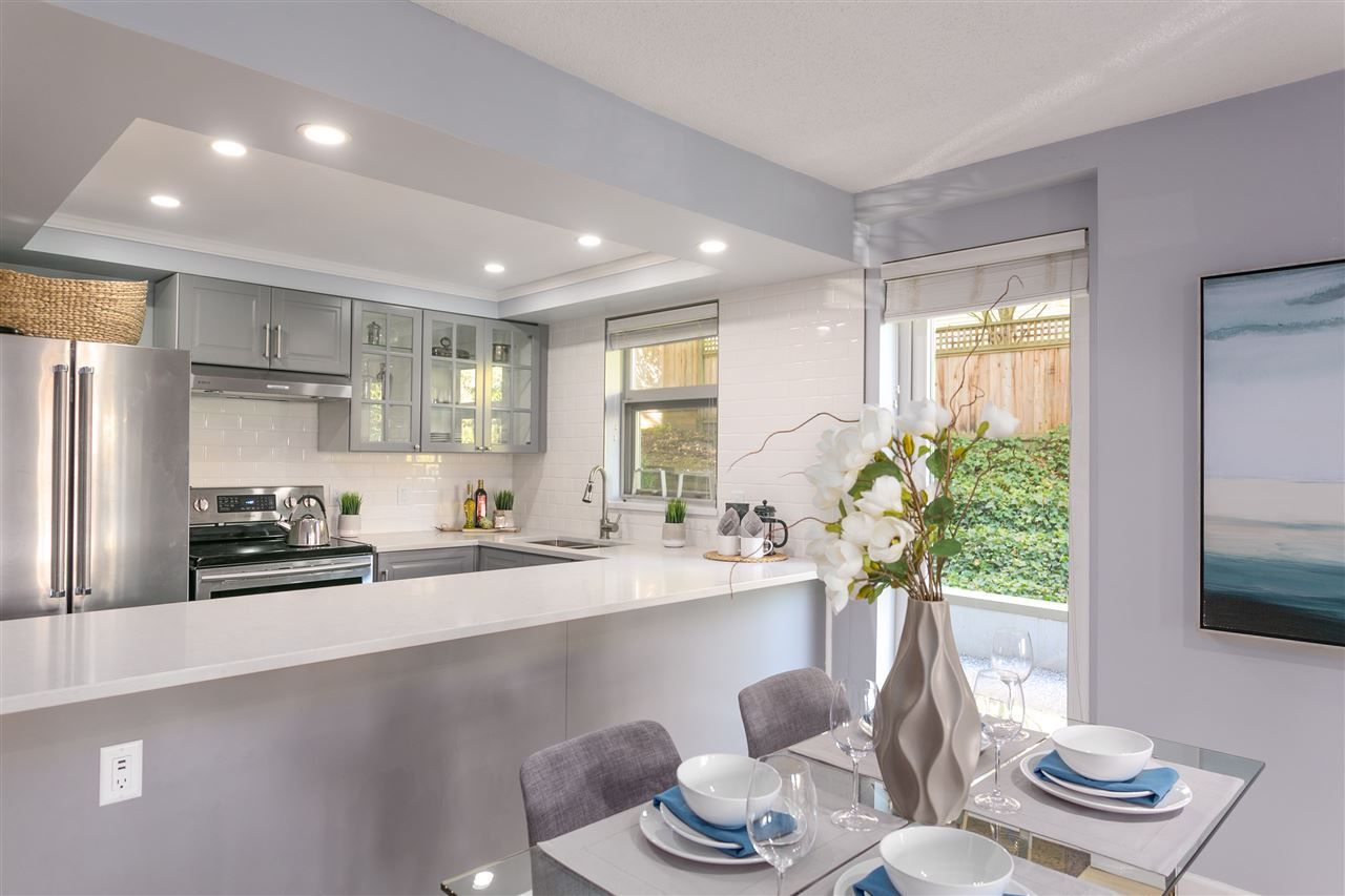 """Photo 2: Photos: 106 2428 W 1ST Avenue in Vancouver: Kitsilano Condo for sale in """"Noble House"""" (Vancouver West)  : MLS®# R2212887"""