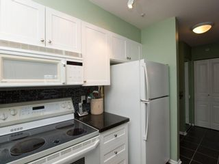 """Photo 10: 412 789 W 16TH Avenue in Vancouver: Fairview VW Condo for sale in """"SIXTEEN WILLOWS"""" (Vancouver West)  : MLS®# V938093"""