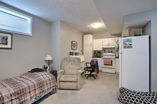 Photo 41: 566 River Heights Crescent: Cochrane Semi Detached for sale : MLS®# A1129968