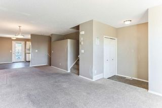 Photo 3: 1106 PRAIRIE SOUND Circle NW: High River Row/Townhouse for sale : MLS®# C4239510