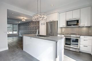 Main Photo: 2402 1 Street SW in Calgary: Mission Row/Townhouse for sale : MLS®# A1155842