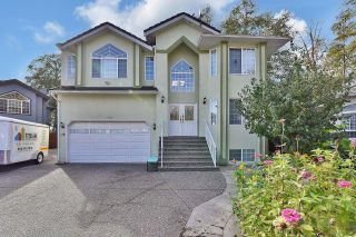 Main Photo: 13706 93A Avenue in Surrey: Bear Creek Green Timbers House for sale : MLS®# R2627330