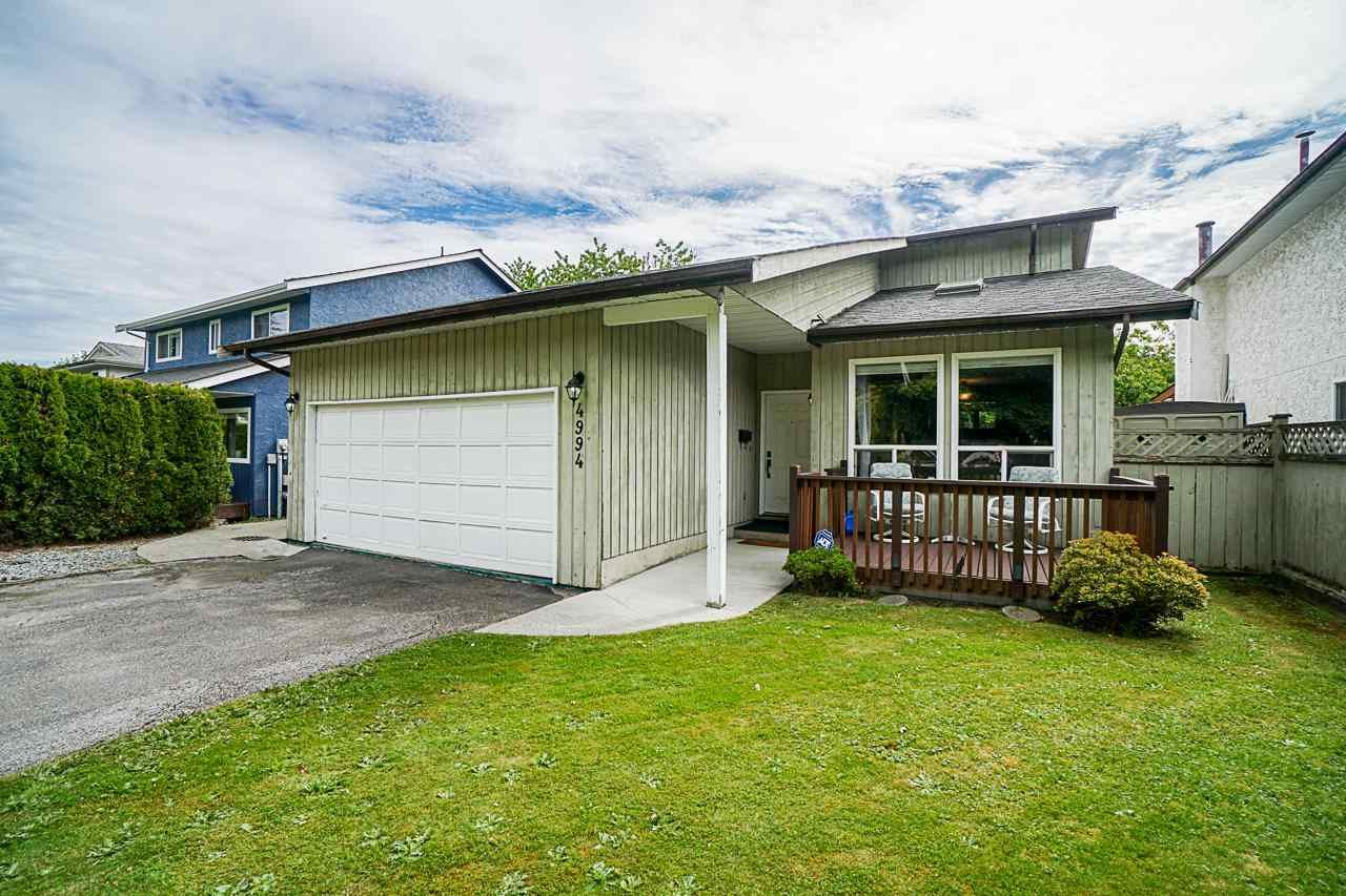 """Main Photo: 4994 207 Street in Langley: Langley City House for sale in """"CITY PARK / EXCELSIOR ESTATES"""" : MLS®# R2587304"""