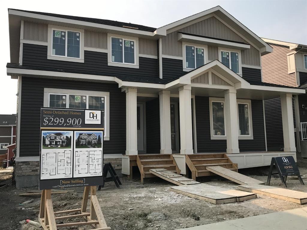 Main Photo: 23 Sunrise Heights: Cochrane Duplex for sale : MLS®# A1017998