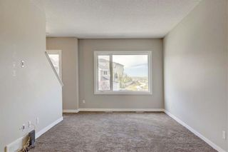 Photo 7: 102 501 RIVER HEIGHTS Drive: Cochrane Row/Townhouse for sale : MLS®# C4266118