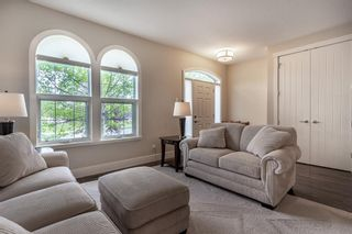 Photo 4: 270 Quarry Park Boulevard SE in Calgary: Douglasdale/Glen Row/Townhouse for sale : MLS®# A1141853