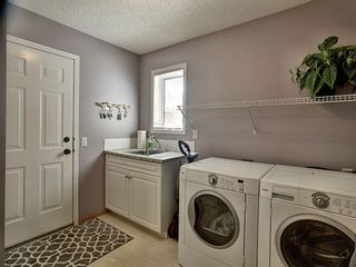 Photo 12: 12 Sienna Heights Way SW in Calgary: Signal Hill Detached for sale : MLS®# A1099178