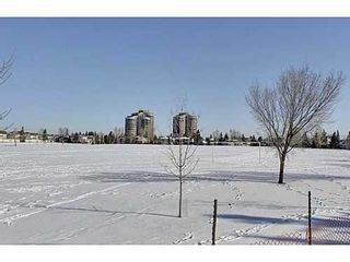 Photo 20: 19 828 COACH BLUFF Crescent SW in Calgary: 2 and Half Storey for sale : MLS®# C3563691