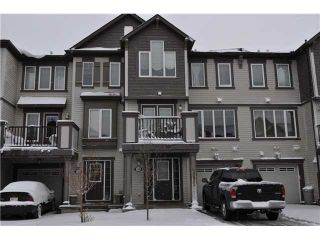 Photo 1: 118 WINDSTONE Crescent SW: Airdrie Townhouse for sale : MLS®# C3590682