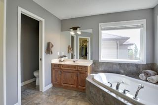 Photo 24: 145 TREMBLANT Place SW in Calgary: Springbank Hill Detached for sale : MLS®# A1024099