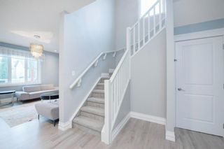Photo 4: 48 Tremblant Terrace SW in Calgary: Springbank Hill Detached for sale : MLS®# A1131887