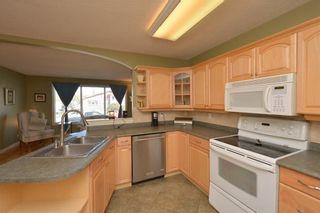 Photo 13: 267 GLENPATRICK Drive: Cochrane House for sale : MLS®# C4139469