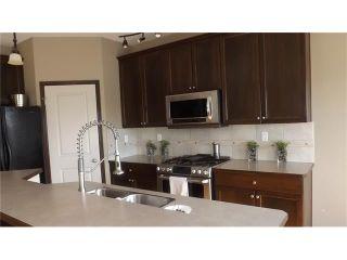 Photo 7: 155 SUNSET Close: Cochrane House for sale : MLS®# C4037159