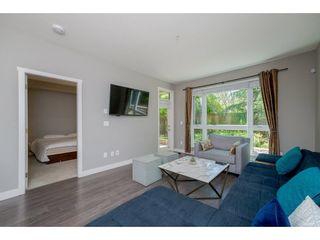 Photo 4: 105 14358 60 Avenue in Surrey: Sullivan Station Condo for sale : MLS®# R2278889