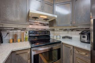"""Photo 13: 410 8068 120A Street in Surrey: Queen Mary Park Surrey Condo for sale in """"Melrose Place"""" : MLS®# R2464731"""